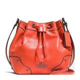 COACH/蔻驰 女士新款牛皮时尚抽绳斜挎包单肩包35363桔色